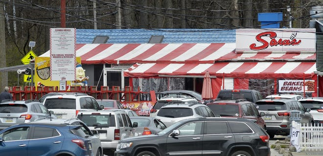 Customers visit Sara's Restaurant on opening day, April 23, 2020. The traditional April 1 opening day was delayed due to the COVID-19 pandemic.