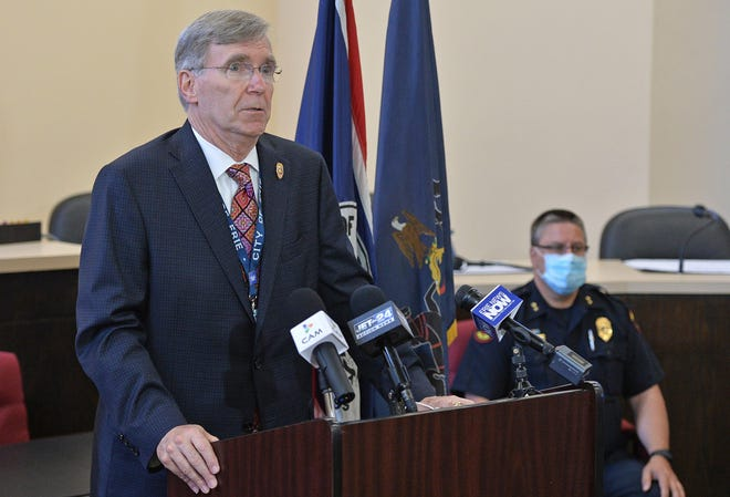 Erie Mayor Joe Schember is shown at a May 30 news conference, with Erie Bureau of Police Chief Dan Spizarny in the background. Both Schember and Spizarny, along with a number of city police officers and firefighters, have received the COVID-19 vaccine.