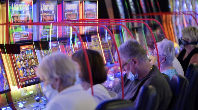 Clear plastic dividers were placed between slot machines at Presque Isle Downs & Casino, shown on the first day of re-opening under the green phase on June 26, 2020.