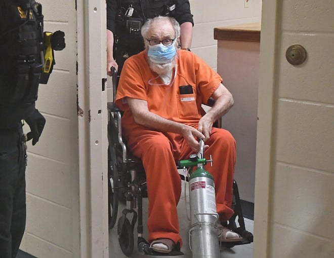 At the Erie County Courthouse on June 25, Raymond Payne is led to a degree-of-guilt hearing in the 1975 murder of Debbie Gama.