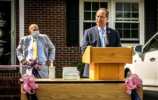 U.S. Rep. Greg Murphy speaks to a small crowd while Craven County Commission chairman Tom Mark watches.