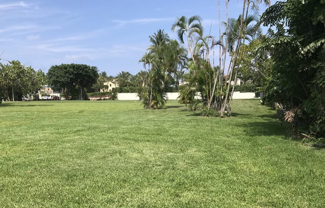 Seen in the foreground, a vacant lot of nearly a half-acre sold this month for a recorded $6.898 million at 127 El Bravo Way on the corner of South County Road. The lot is part of a subdivision carved from land that was once part of an estate owned by billionaire John Kluge.