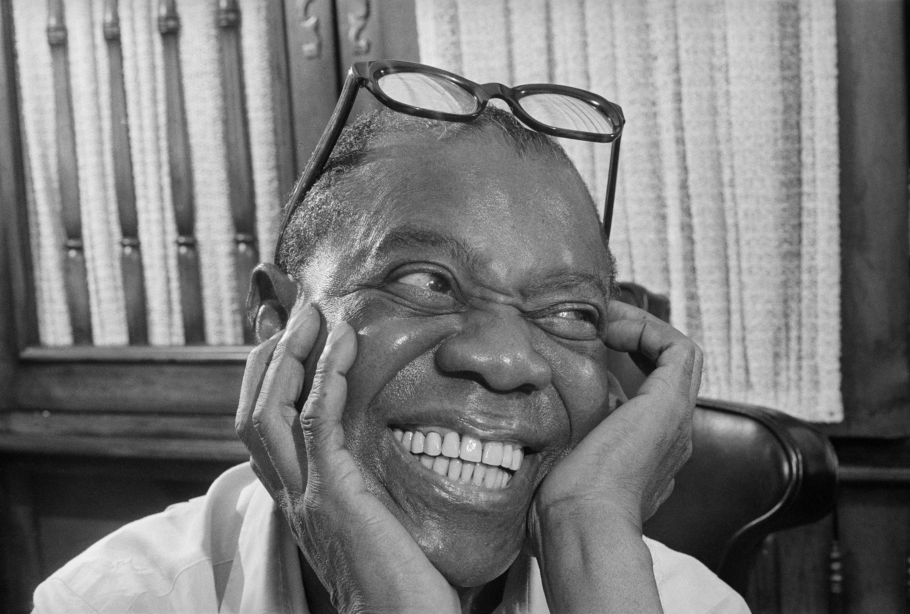 Jazz musician Louis Armstrong smiles as he recalls the old days during an interview at his home in Queens, New York, on June 10, 1970.