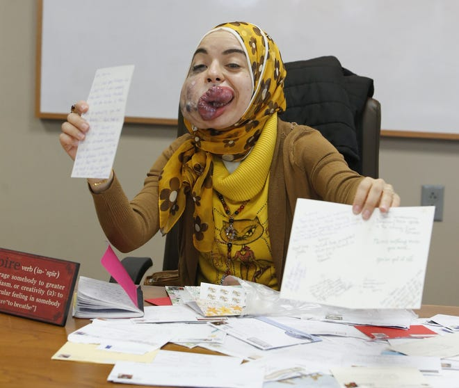 Lamise ElBetar shows cards of encouragement she received during a meeting of Team Lamise at the University of Akron's College of Business Administration in December 2018 in Akron.