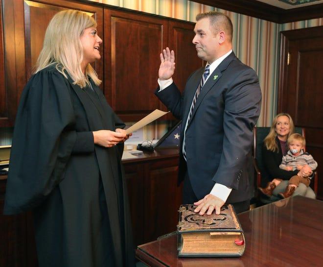 Judge Joy Malek Oldfield swears in Barberton Mayor William Judge for a third term Jan. 3, 2020 in Barberton, Ohio.
