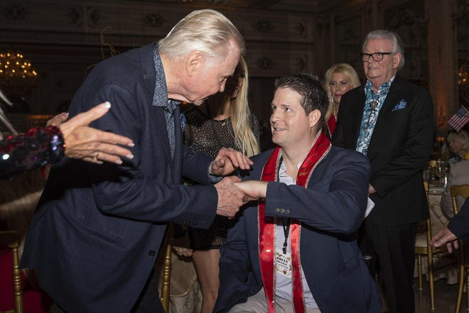 Actor John Voight greets Brian Kolfage, Iraq War veteran and founder of a viral online campaign to raise funds for President Trump's border wall, during the Trumpettes USA Gala at Mar-a-Lago in Palm Beach, FL, on Saturday, February 23, 2019.