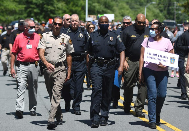 Wilmington Interim Police Chief Donny Williams leads a peace march down 6th St. from the Wilmington Police Department headquarters to the 1898 Memorial Park in Wilmington, N.C., Tuesday, June 3, 2020.