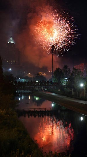 Fireworks explode over the Towpath Trail near Canal Park in downtown Akron. This year, fireworks will be launched at 9:45 p.m. from the Akron Executive Airport, Patterson Park Ballfields, Summit Lake and the State Street Parking Deck in downtown Akron.