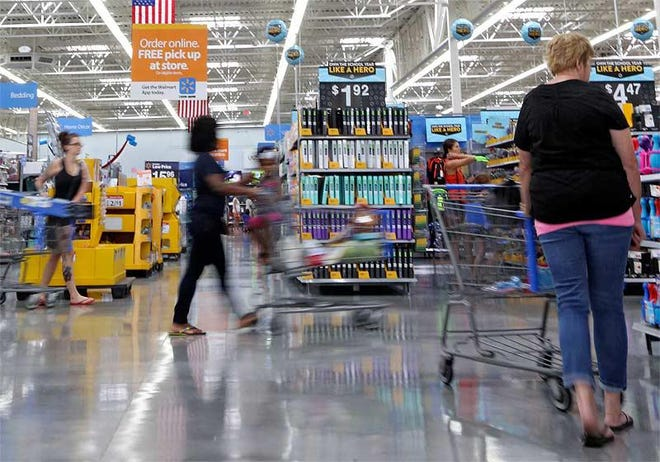 Shoppers hunt for back-to-school items at a Walmart in Dublin in a previous Ohio sales tax holiday.