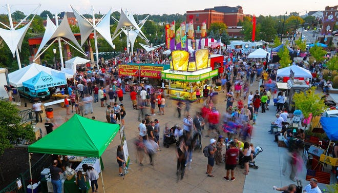 Thousands flood Front Street for Cuyahoga Falls Oktoberfest in 2019. The 2020 event was canceled because of COVID-19, but is returning in 2021. The festival will happen on Sept. 17, 18 and 19.