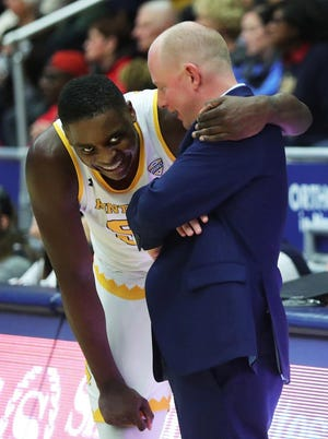 Freshman center Kalin Bennett hugs Kent State coach Rob Senderoff after being put into the game with five minutes left in the season opener against Hiram College on Nov. 6, 2019, at the M.A.C. Center. [Jeff Lange/Beacon Journal file]