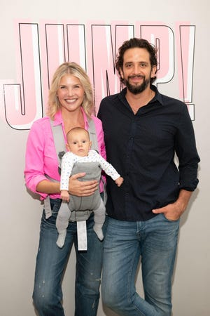 Amanda Kloots and Nick Cordero, with their son, Elvis, attend the Beyond Yoga x Amanda Kloots Collaboration Launch Event on Aug. 27, 2019, in New York.