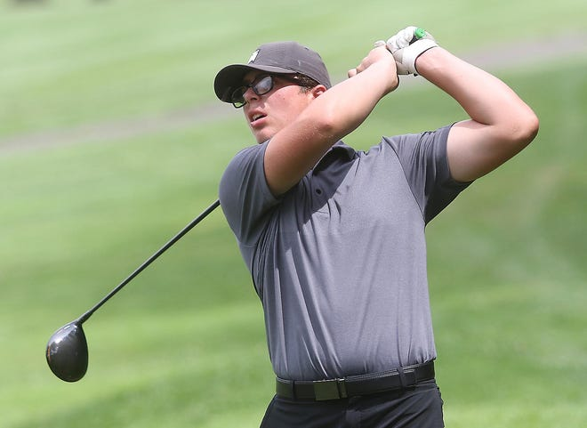 Sandy Valley's Conner Ritter watches his tee shot on the 18th hole at Fire Ridge Golf Course in Millersburg during Wednesday's during the Inter-Valley Conference Preseason Tournament. Ritter shot a school-record 7-under 65.
