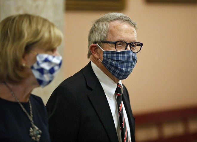 Ohio Gov. Mike DeWine and First Lady Fran DeWine leave the State Room after giving update on the state's response to the ongoing COVID-19 pandemic in April.