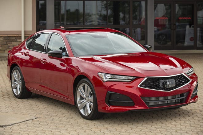 The newly-redesigned 2021 Acura TLX on display outside of the Honda of America Manufacturing plant in Marysville. Acura hopes the design is different enough to appeal to luxury car drivers even in a challenging moment for passenger car sales.