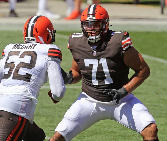 Cleveland Browns rookie left tackle Jedrick Willis Jr., right, blocks defensive end Robert McCray during practice at FIrstEnergy Stadium on Sunday, Aug. 30, 2020, in Cleveland, Ohio.
