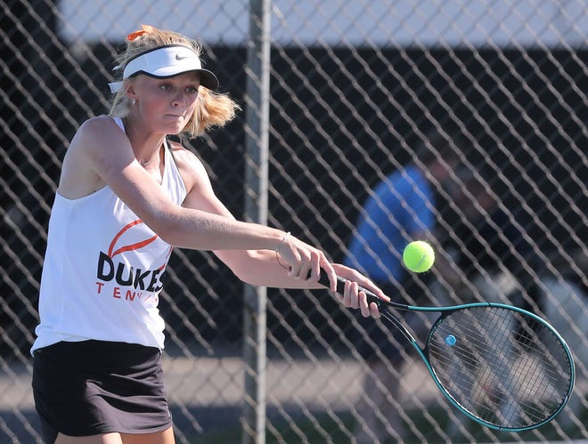 Marlington's Mary Mason returns a shot during her no. 1 match against Massillon's Keeley White at Marlington on Thursday, August 20, 2020.