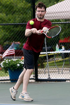 Jim Norris returns a shot during last year's Times-Gazette Tennis Open.