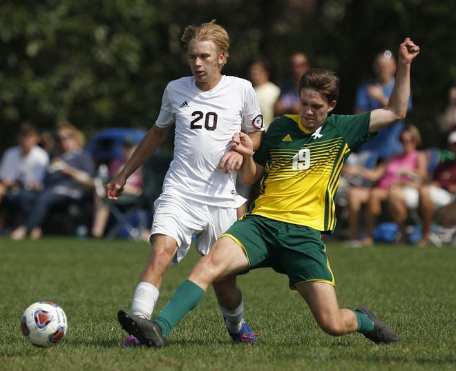 Firestone's Jackson Smucker kicks the ball away from Stow's Tristen Mattson (20) at the Copley Road Soccer Complex onSept. 21, 2019, in Akron, Ohio.