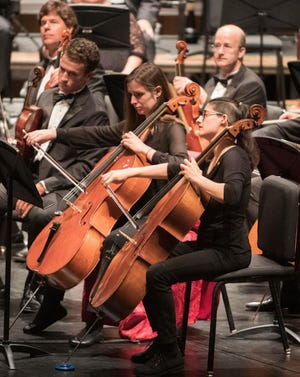 Cellist Erica Snowden-Rodriguez, far right, is shown playing with the Akron Symphony Orchestra.