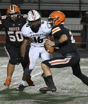 McKinley's Mani Powell (16) closes in on Hoover quarterback Connor Ashby during last year's game at Memorial Stadium. Sept. 27, 2019.