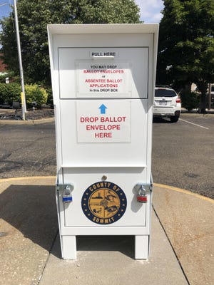 The Summit County Board of Elections, 470 Grant St., has a secure drop box located outside of its facility for voters to turn in their absentee ballots.