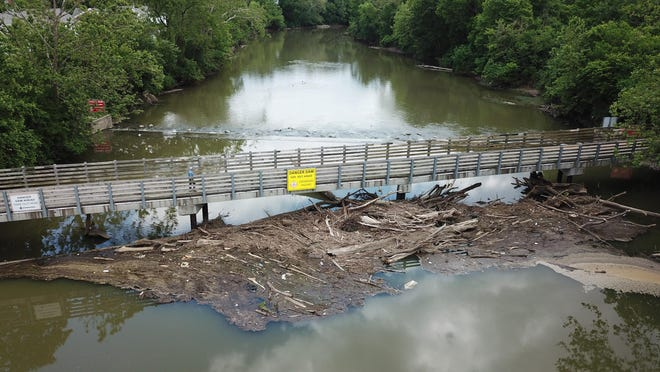 Debris, including huge trees felled during spring rains, have created logjams under bridges, behind lowhead dams and along stream banks. This jam on the Olentangy River is between the the Wilma H. Schiermeier Olentangy River Wetland Research Park and Olentangy Village apartments.