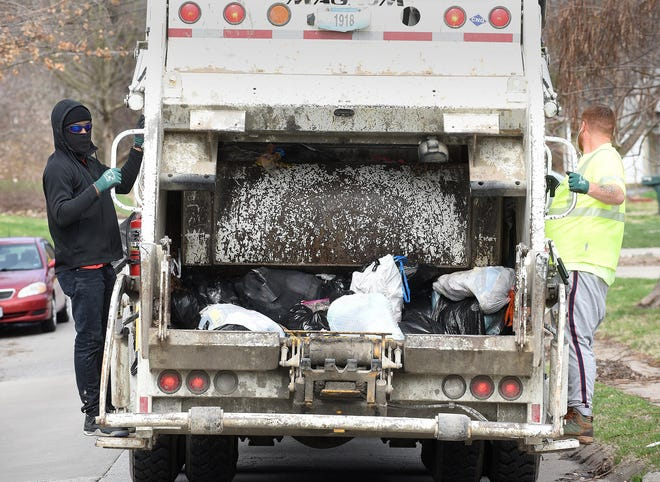 Columbia garbage collectors work earlier this year.