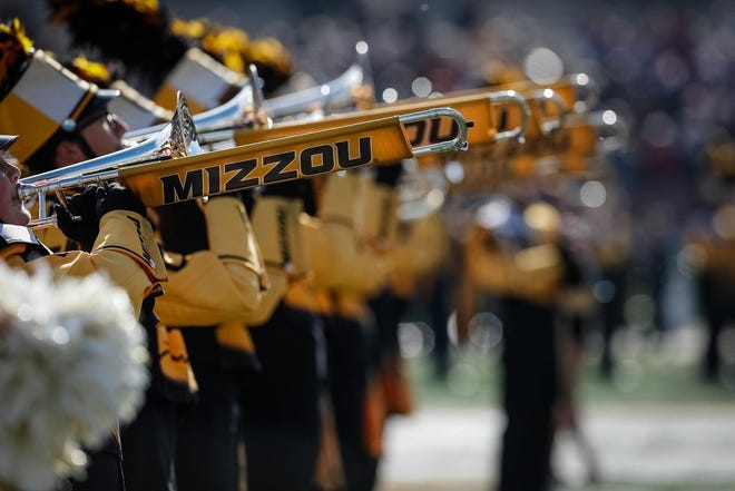 Marching Mizzou members perform during a football game in 2019.
