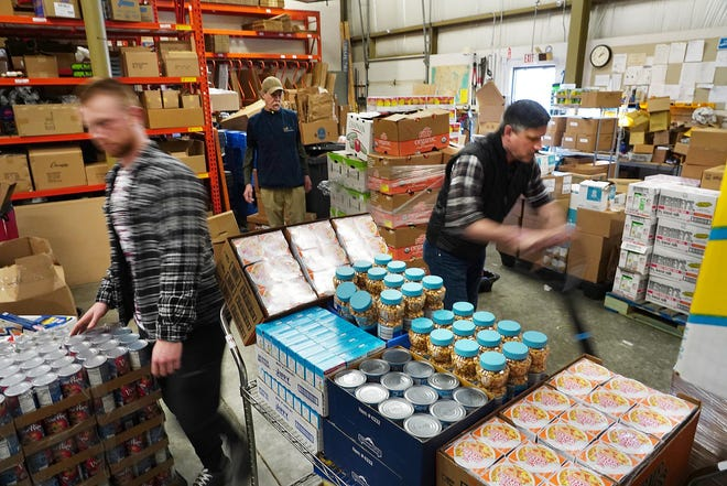Volunteers at Gather food pantry in Portsmouth.