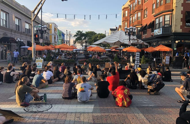 As diners ate at outdoor tables in DePasquale Square on Monday night, over 100 protesters blocked traffic in the intersection facing them, chanted slogans calling for racial justice in America.