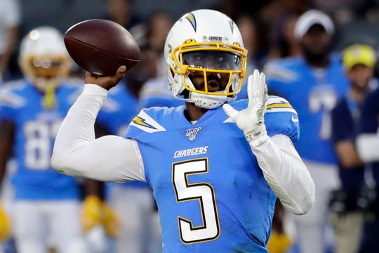 In this Aug. 25, 2019, file photo, Los Angeles Chargers quarterback Tyrod Taylor throws the ball downfield against the Seattle Seahawks during the first half of an NFL preseason football game in Carson, Calif. Los Angeles Chargers QB Tyrod Taylor is confident going into his first NFL start in nearly two years.