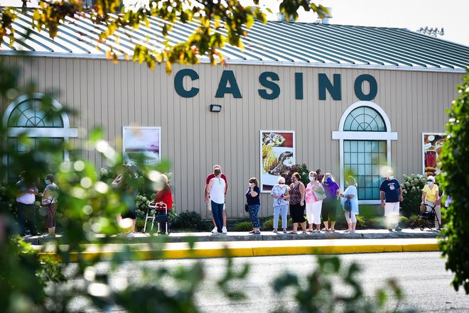 Patrons wait in line outside of Vernon Downs Casino Hotel last year. It reopened Sept. 9, 2020.