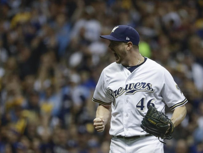 Milwaukee reliever Corey Knebel is jubilant after striking out the Dodgers' Manny Machado in the 2018 National League Championship Series. Knebel missed all of last season because of elbow surgery.