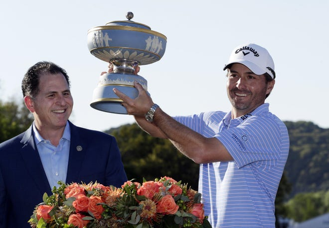 Kevin Kisner, right, holds his trophy presented by Michael Dell, CEO of Dell Technologies, after he won the 2019 Dell Technologies Match Play tournament at the Austin Country Club.