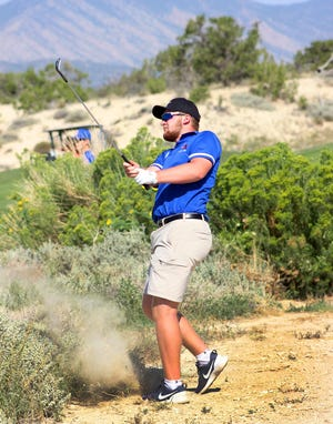 Swallows Charter Academy golfer Ben Compton shoots from the rough onto the green at the par 4 hole No. 1 at Four Mile Ranch Golf Club in Canon City last season.