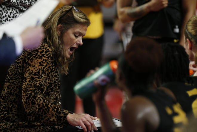Missouri women's basketball coach Robin Pingeton speaks with her team in a timeout during a Southeastern Conference game against Georgia on Feb. 6 in Athens, Ga.