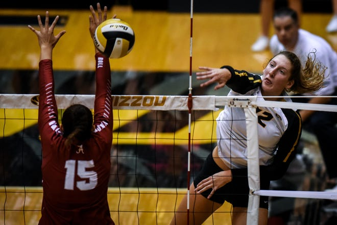 Missouri outside hitter Kylie Deberg (12) hits the ball during a 2018 match at the Hearnes Center.