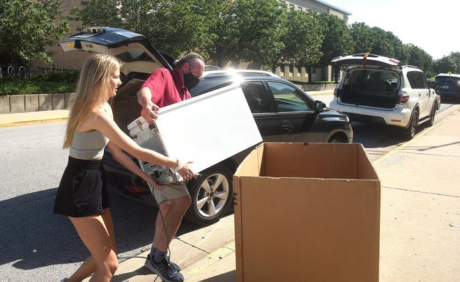 Brianna Whitener of St. Louis  helps her dad, John Whitener, load a refrigerator into a moving box Wednesday while moving into Johnston Hall at the University of Missouri. Whitener is a junior who will be applying for the diagnostic medical ultrasound program.
