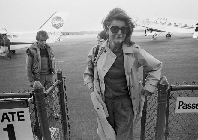 In this Nov. 21, 1983 file photo Jacqueline Kennedy Onassis arrives at the Barnstable Airport, in Hyannis, Mass., to observe the 20th anniversary of the assassination of President John F. Kennedy. The Martha's Vineyard estate of the former first lady is being sold to a pair of nonprofits that plan on turning the property into conservation land open to the public, officials said Thursday, Sept. 3, 2020.