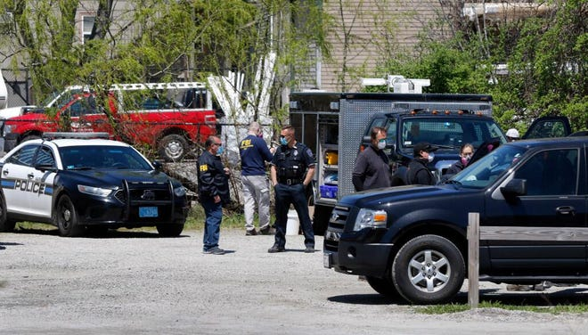 Warwick police officers and FBI agents gather behind the Remington House in Warwick on May 5, the day David Adler Staveley was arrested.