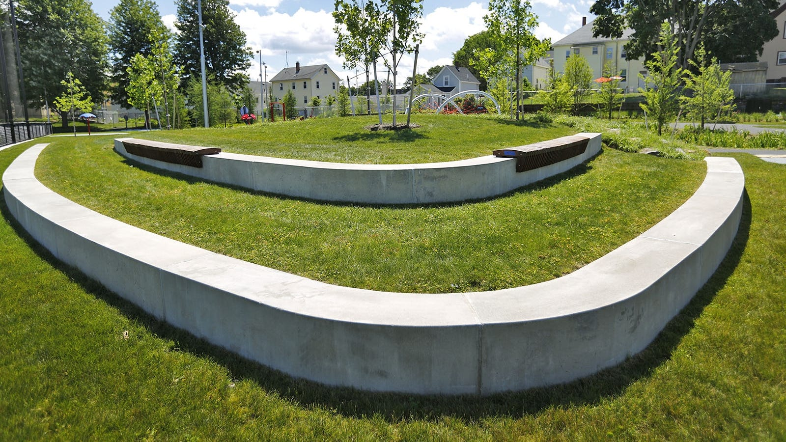 A heavily landscaped sitting area near the playground at Kincaide Park in Quincy.