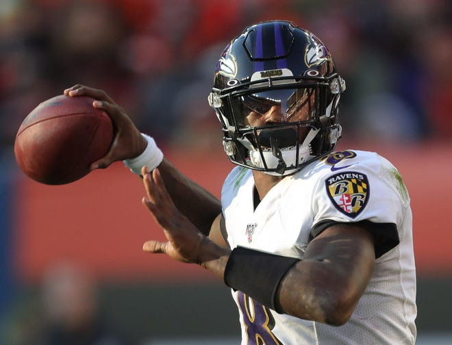 Baltimore Ravens quarterback Lamar Jackson looks downfield for a receiver during a game last season against the Browns. [Jeff Lange/Beacon Journal file]