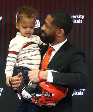Cleveland Browns general manager Andrew Berry, right, shares a moment with his son Zion, 2, during his introductory press conference at the Cleveland Browns training facility, Wednesday, Feb. 5, 2020, in Berea, Ohio.