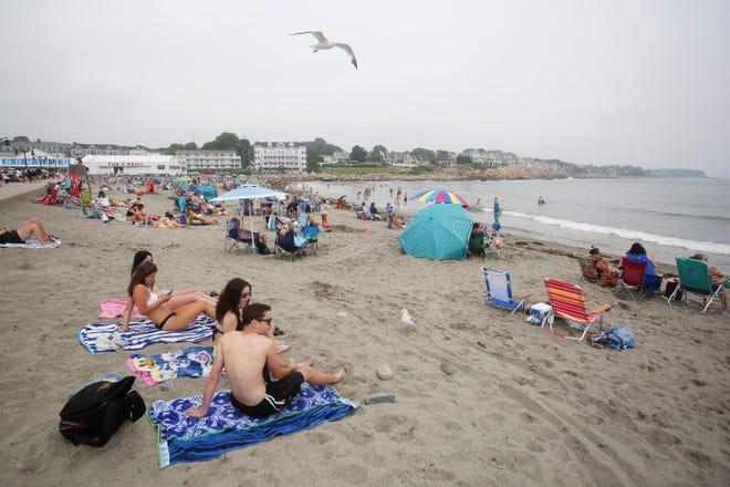Beachgoers enjoy Short Sands Beach on Sunday, July 5, 2020, amid the COVID-19 pandemic.