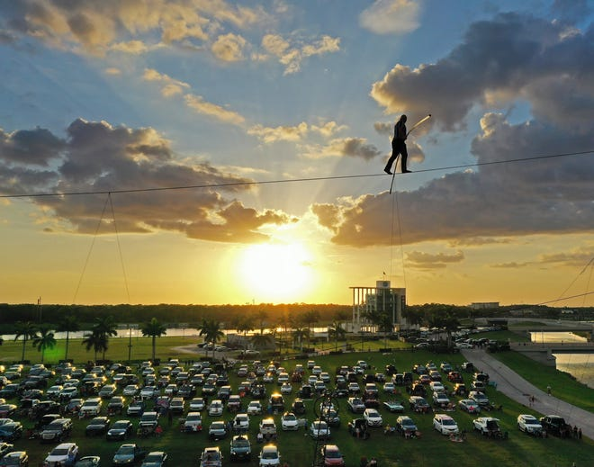 Sarasota native Nik Wallenda returns to the skies over Nathan Benderson Park with his Daredevil Rally Drive-in Thrill Show Feb. 26-28 and March 4-7. Wallenda is seen here walking over Benderson Park on June 12, 2020.