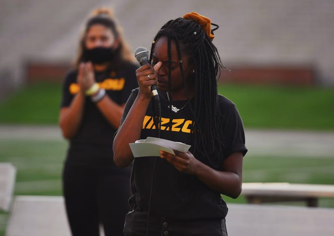 Missouri soccer player Keiarra Slack pauses as she speaks to the crowd during a sit-in Sept. 2 at Faurot Field.