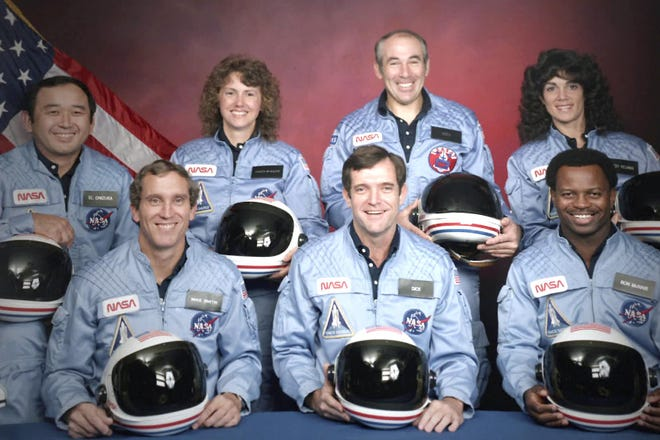 """This image released by Netflix shows members of the Challenger 7 crew - Ellison S. Onizuka, Mike Smith, Christa McAuliffe, Dick Scobee, Gregory Jarvis, Judith Resnik and Ronald McNair (from left). """"Challenger: The Final Flight,"""" a four-part series about the space shuttle disaster, premieres Wednesday."""