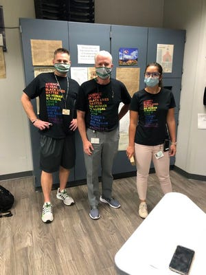Dublin Scioto High School teacher Scott Marple, left,, principal Bob Scott and assistant principal Leanndra Yates were included in this photo posted Sept. 10 on the school's Twitter account. The politically oriented statements on the T-shirts have prompted a debate in the community.
