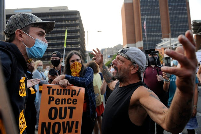 Supporters of President Donald Trump and protesters interact with each other at Independence Mall, Tuesday, Sept. 15, 2020, in Philadelphia. President Trump participated in a town hall at the National Constitution Center. (AP Photo/Michael Perez)